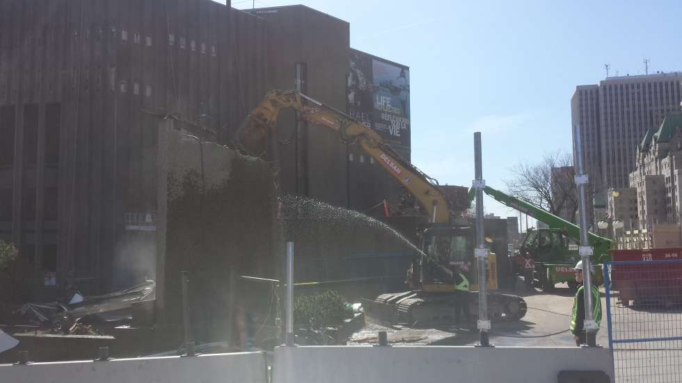 The NAC's digital marquee is demolished to provide space for the new Elgin St. building entrance.