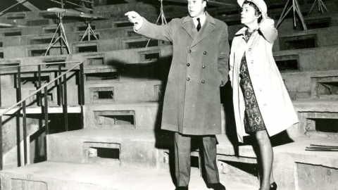 Hamilton Southam, director-general of the National Arts Centre in Ottawa, tours the centre as it nears completion. With Mr. Southam is Mary Joliffe, the centre's public relations director. 1969 handout photo; construction